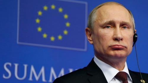 Russian President Putin speaks at a news conference after an EU-Russia Summit in Brussels