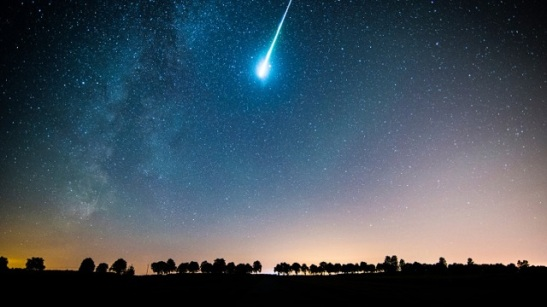 Low Angle View Of Meteor Shower And Star Field In Sky